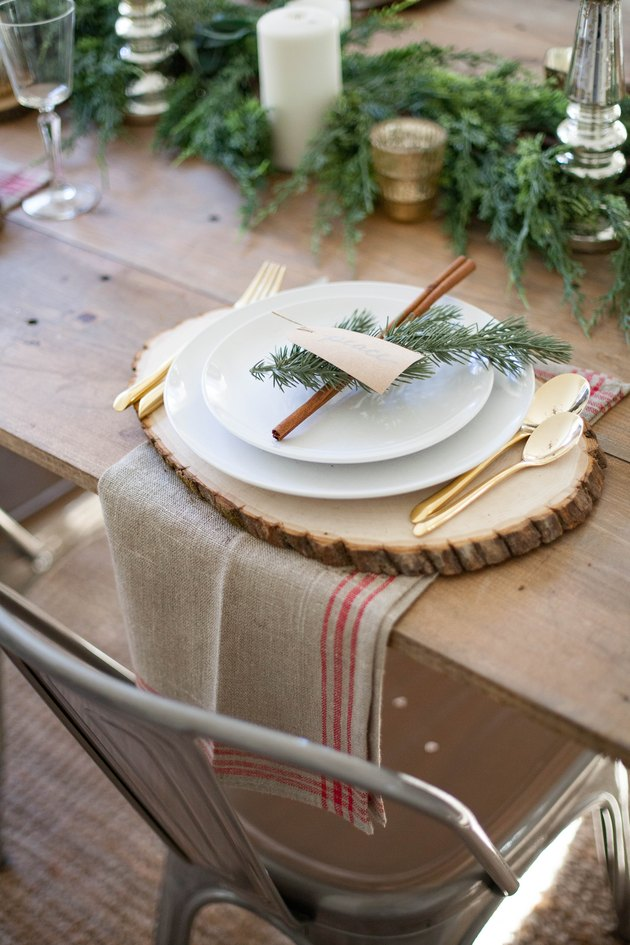 Rustic Christmas decorations on table with wood slices and tea towels