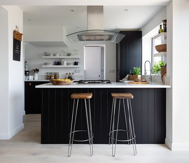 midcentury small kitchen design idea with black cabinets