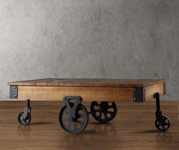 Industrial furniture, Hayneedle coffee table with wood top and black metal wheels