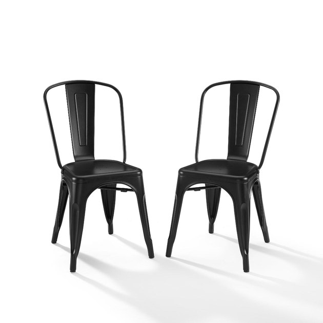 Industrial furniture, World Market dining chairs in black metal with vintage visuals