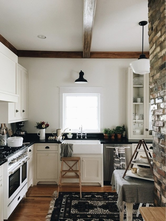 farmhouse small kitchen design idea with brick wall and exposed ceiling beam