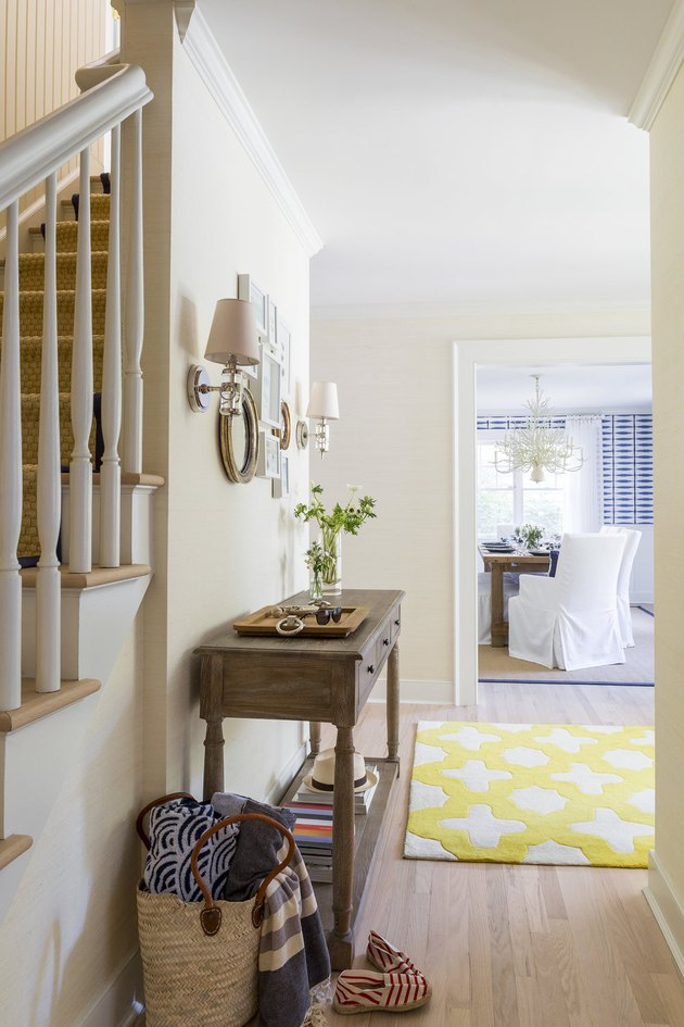 Champagne color painted entryway designed by Chango & Co