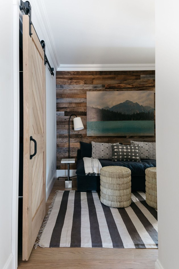 living room with industrial wallpaper that looks like reclaimed wood planks