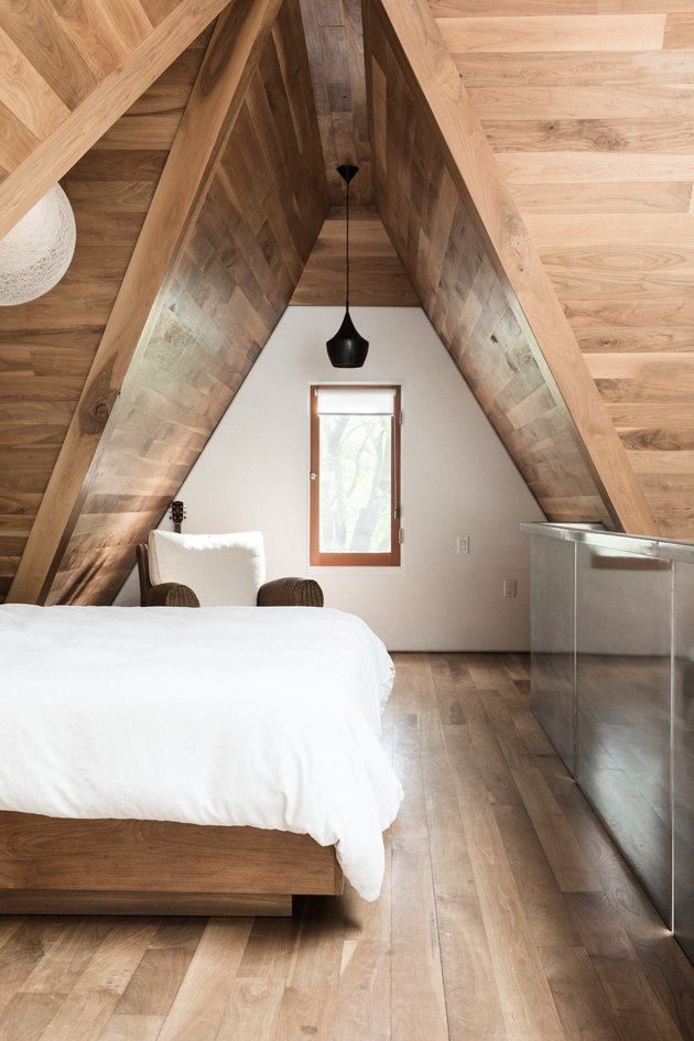attic bedroom lighting ideas with wooden ceiling and pendant light