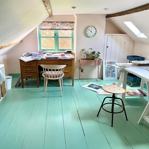 vintage attic office idea with painted wood floors and matching window trim