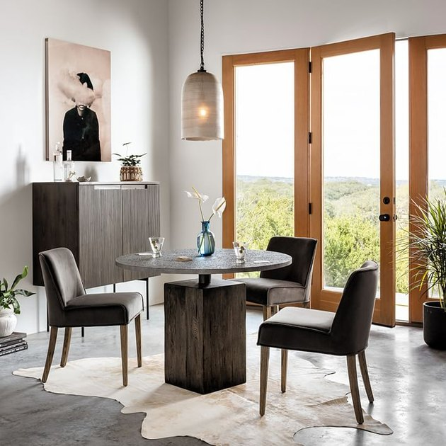 industrial furniture in dining room with round table and chairs