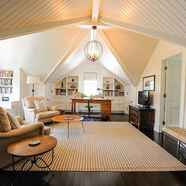 traditional attic office idea with English roll arm chairs and area rug