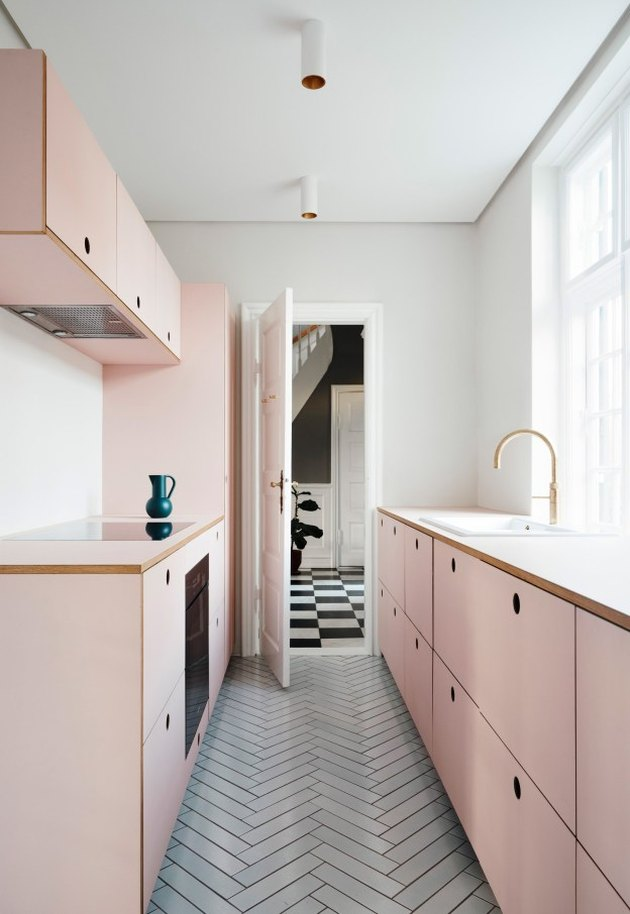 IKEA cabinets with Reform's Basis fronts and pink linoleum kitchen countertops
