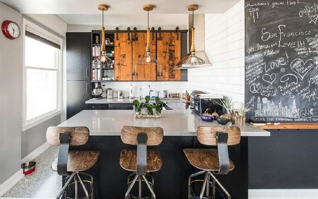 Industrial small kitchen design idea with pendant lights and rustic barstools