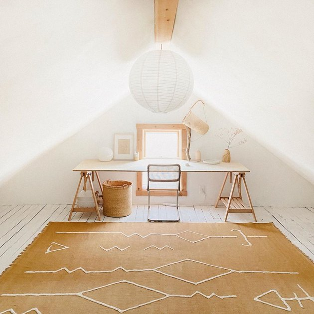 minimalist attic office idea with ochre rug and wood desk