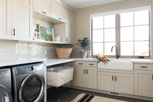 Champagne color painted laundry room by Studio McGee