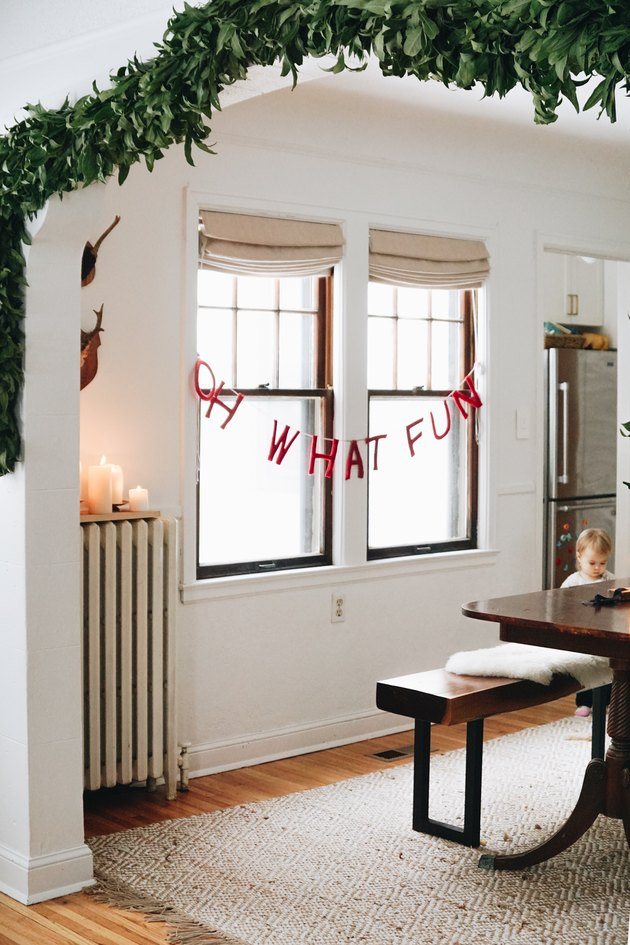 white living room with lettered Christmas window decorations