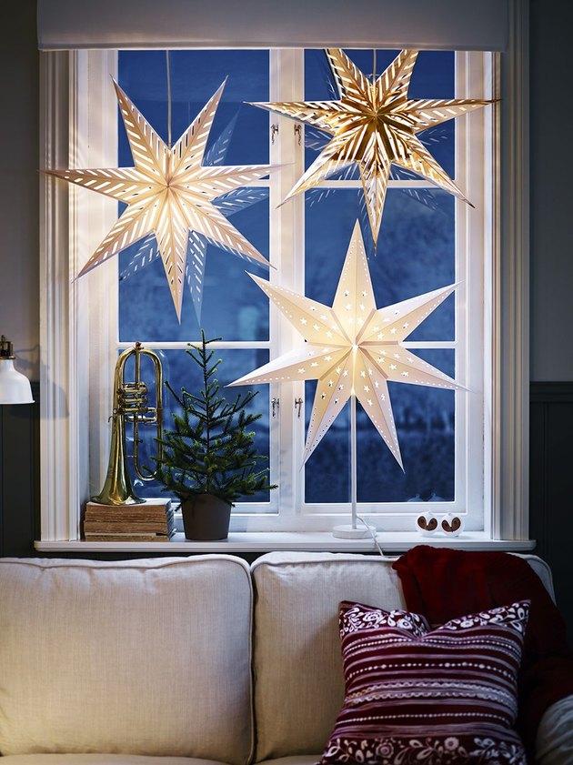 blue window with star light lantern Christmas window decorations