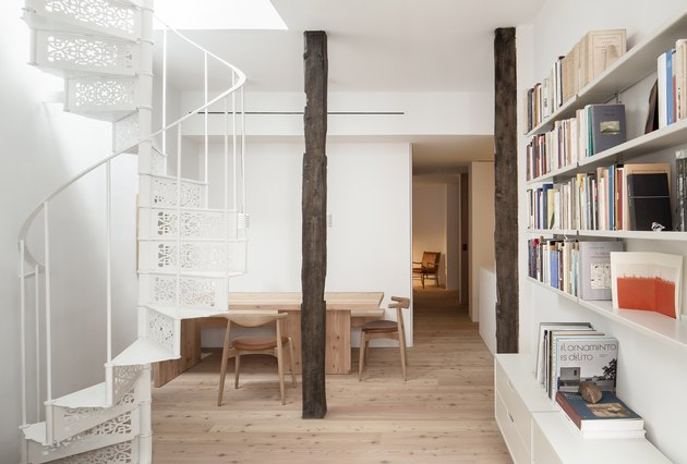 staircase, table with chairs, and bookcase