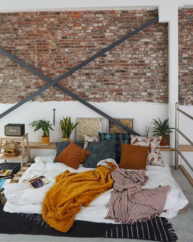 industrial style apartment bedroom with X-brace wall support