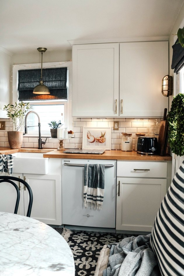 Alternative kitchen lighting idea under cabinets with wood countertops and patterned tile floor