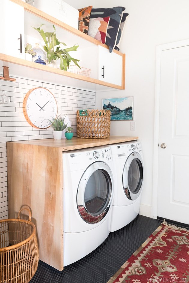 modern laundry room with storage cabinet and area rug