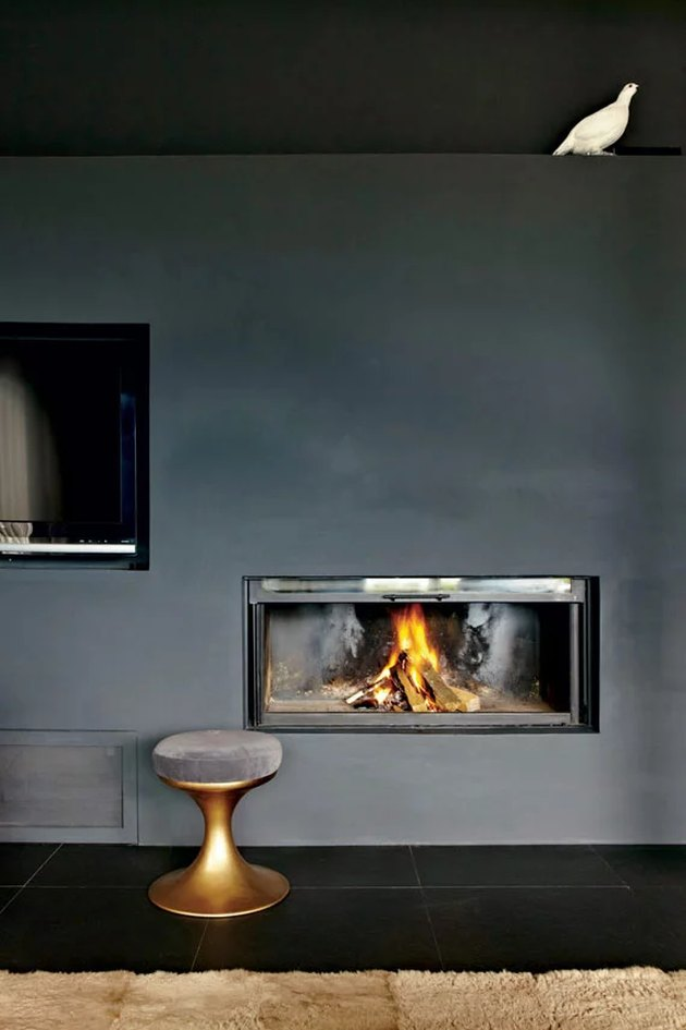 fireplace against dark wall