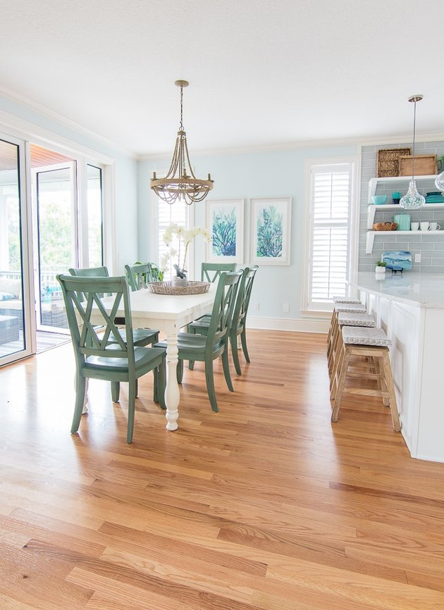 aqua color blue dining room with green chairs and wood floors