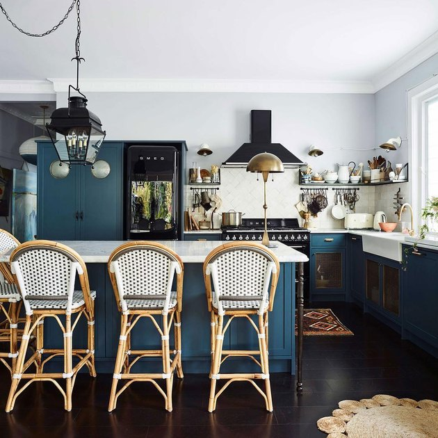 Table lamp alternative kitchen lighting idea with blue cabinets and white countertops