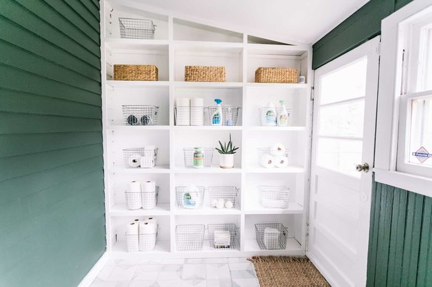 built-in open shelving bookcase in laundry room