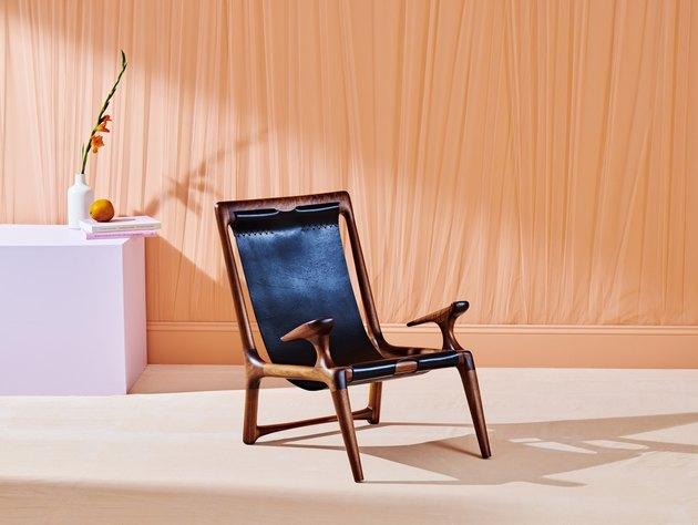 chair near orange curtain and purple table