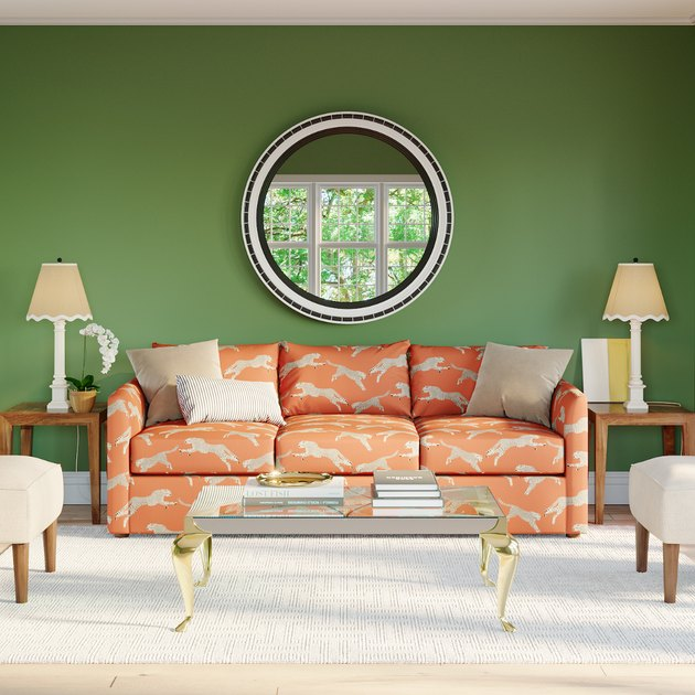 green-walled living room with salmon-colored sofa