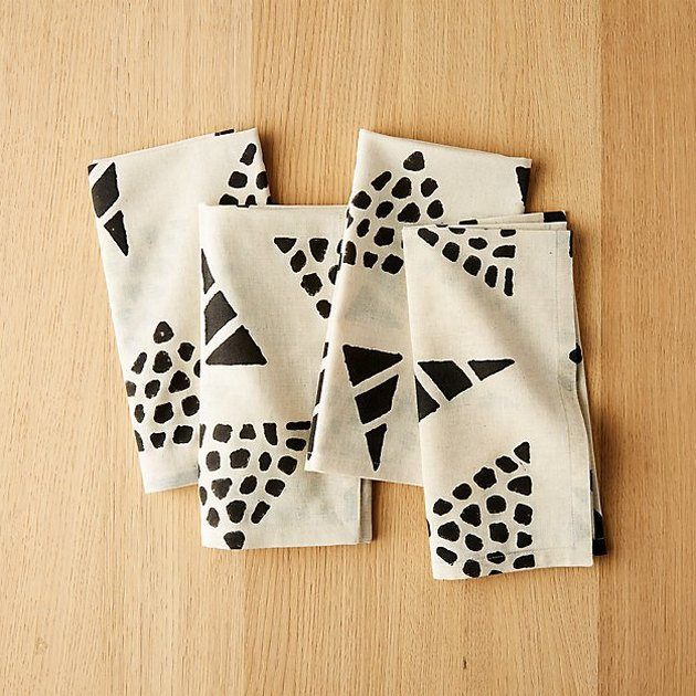 four black and white napkins
