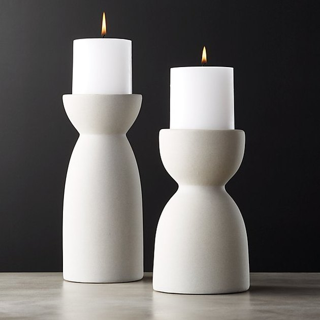 two ceramic pillar candle holders