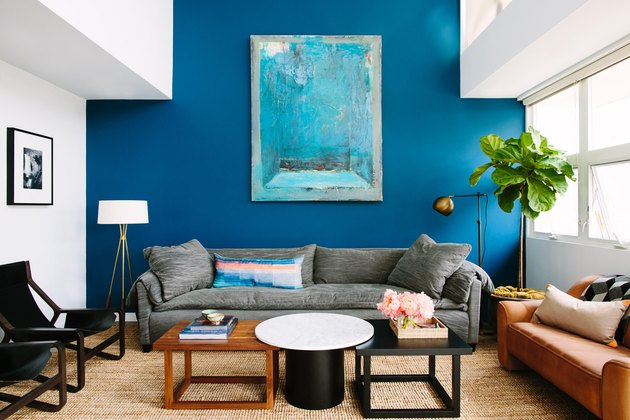 Living room layout idea with blue accent wall and potted tree