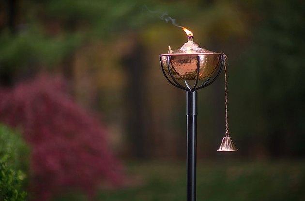 outdoor garden torch in copper