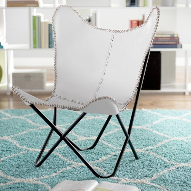 White butterfly chair with black metal base