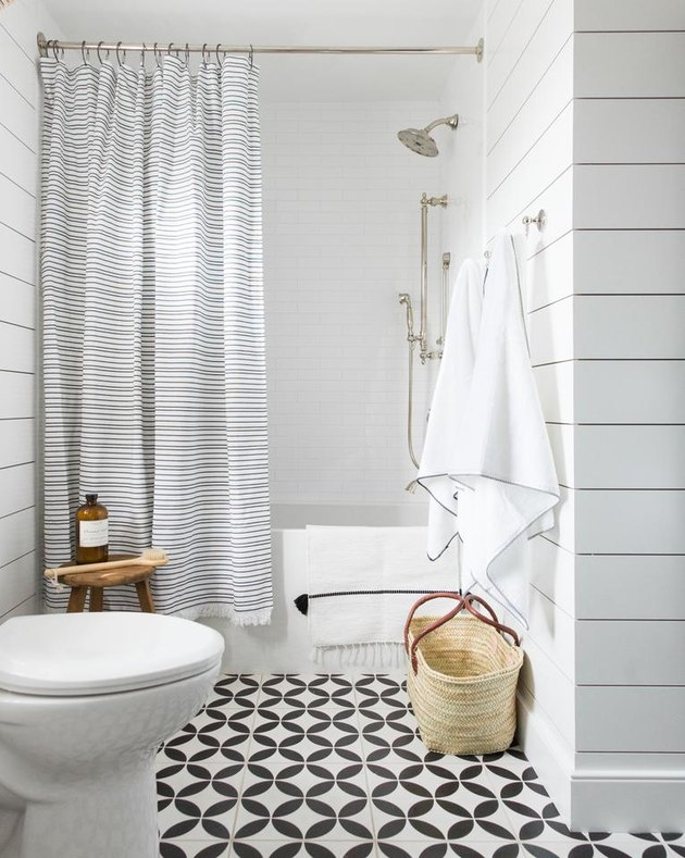 rustic bathroom with striped shower curtain