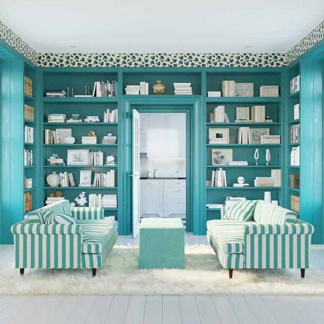 blue library with striped sofas