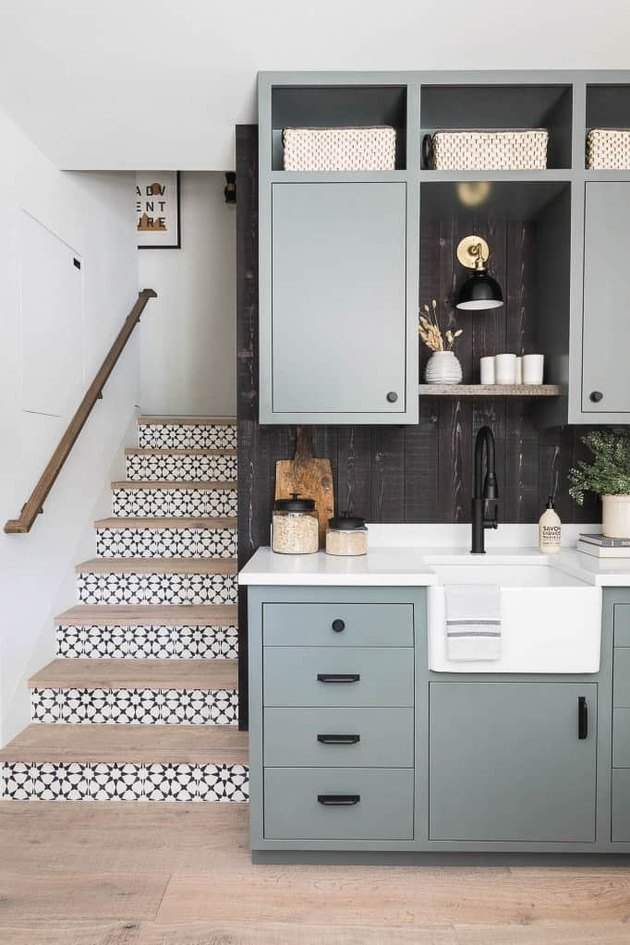 black and white stairs with patterned tile on risers
