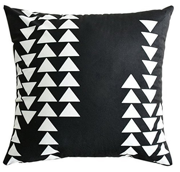 Black throw pillow with white triangles