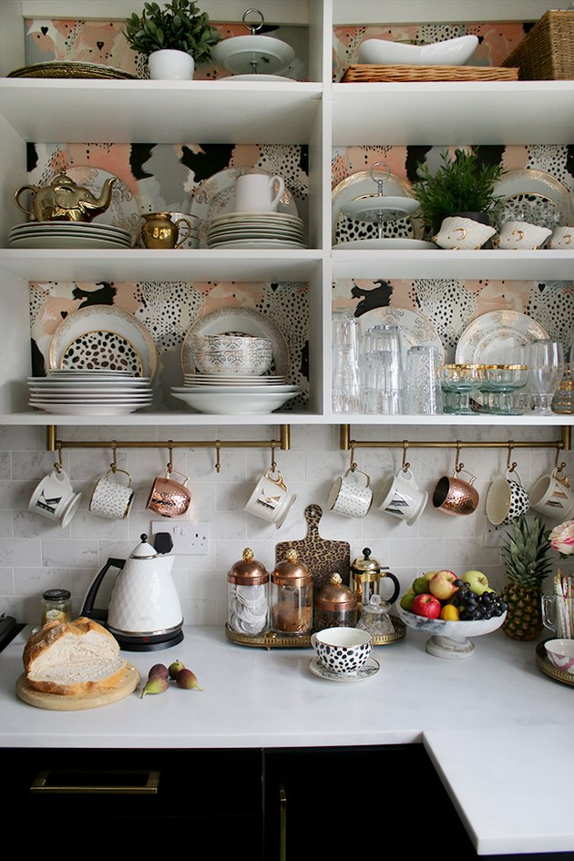 small kitchen storage idea with mugs hanging below upper cabinets