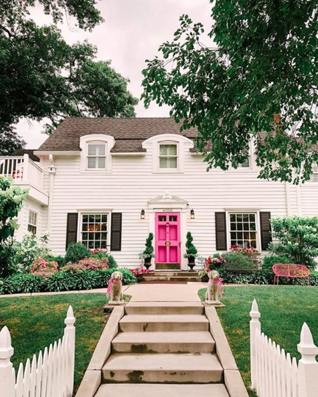 Traditional white exterior house colors with pink door