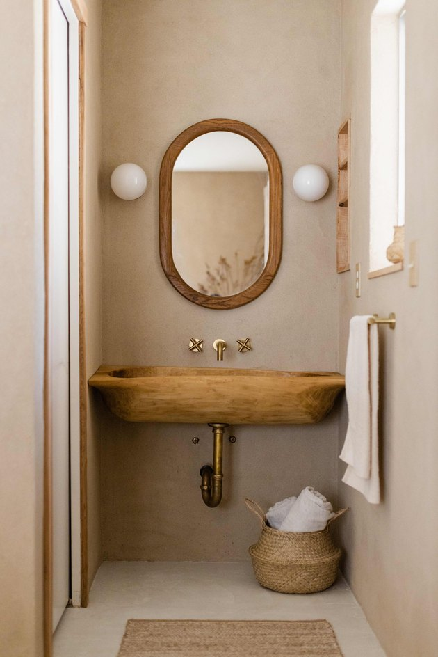 Wooden trough converted into sink.
