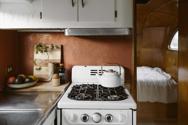 The original cabinets, paneling and stove in the trailer were kept.