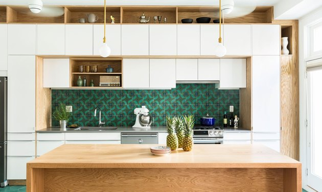 midcentury style green kitchen backsplash in white and oak kitchen