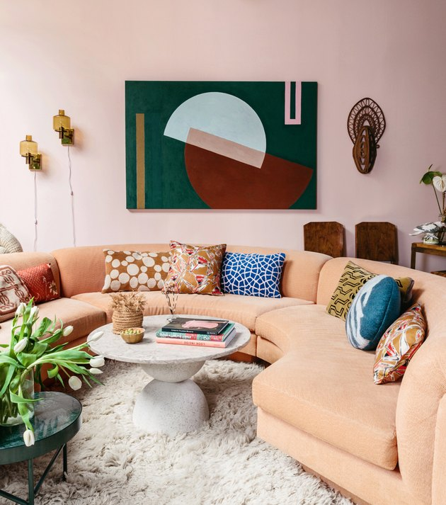 pink maximalist living room with pink sofa
