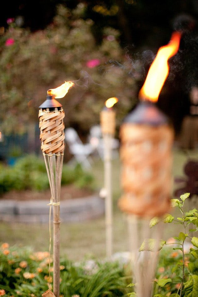 outdoor tiki torches in backyard