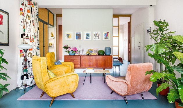 colorful maximalist living room with blue floors