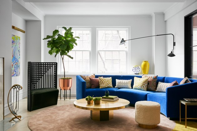 gray maximalist living room with blue sofa