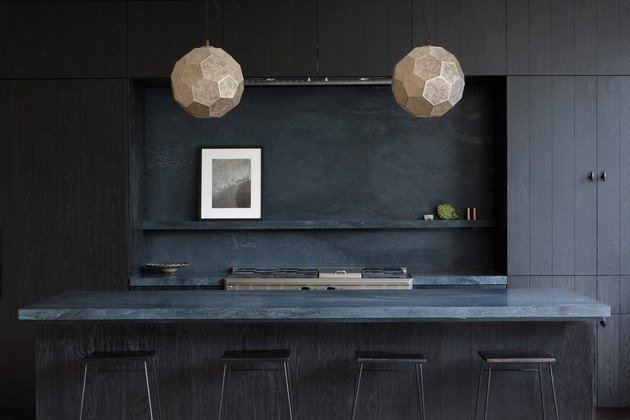 modern kitchen island in all black with blue marble top