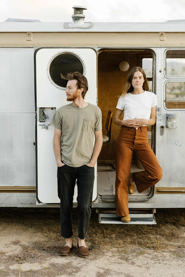 Kelly Brown and Bryce Ehrecke outside of their trailer, Dixie.