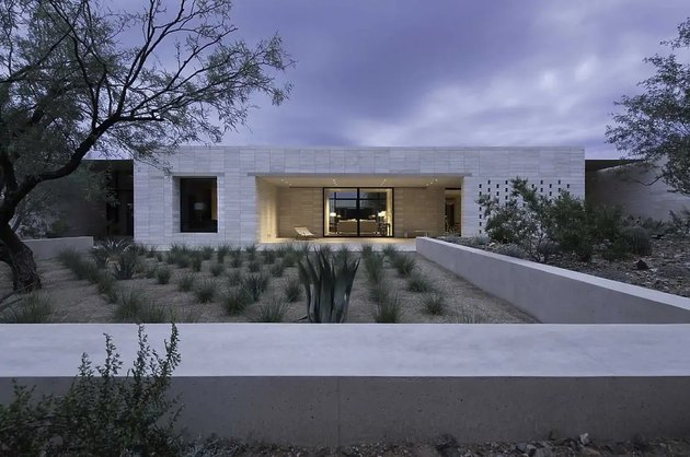 Stone for house exterior with stacked limestone walls and outdoor greenery
