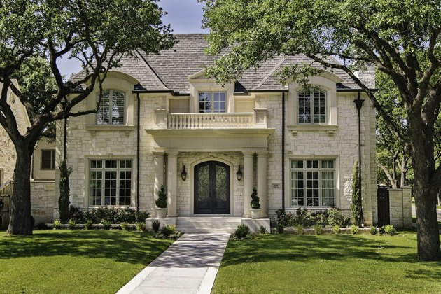 Cream stone for house exterior with balcony