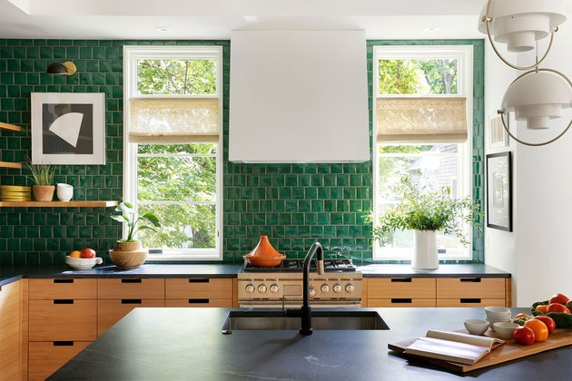glazed green kitchen backsplash with modern details and black countertops
